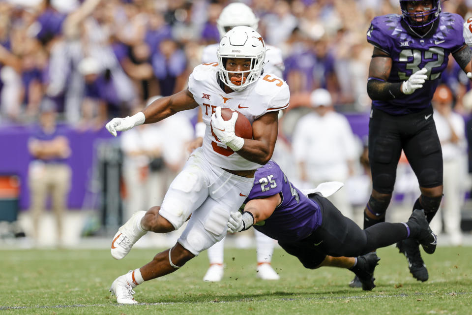 FORT WORTH, TX - OCTOBER 02: Texas Longhorns running back Bijan Robinson (5) runs through the line of scrimmage during the game between the TCU Horned Frogs and the Texas Longhorns on October 2, 2021 at Amon G. Carter Stadium in Fort Worth, Texas. (Photo by Matthew Pearce/Icon Sportswire via Getty Images)