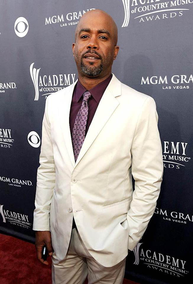 "Darius Rucker  Grade: B   Former Hootie and the Blowfish frontman Darius Rucker opted to pair his crisp white blazer with a purple button-down and matching tie. Salt-and-pepper scruff completed his summery look. Frazer Harrison/ACMA2011/<a href=""http://www.gettyimages.com/"" target=""new"">GettyImages.com</a> - April 3, 2011"