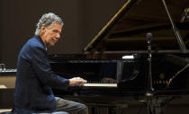 FILE - Chick Corea performs with Eddie Gomez and Brian Blade perform during their concert in Moscow, Russia, on May 15, 2017. Corea, a towering jazz pianist with a staggering 23 Grammy awards who pushed the boundaries of the genre and worked alongside Miles Davis and Herbie Hancock, has died. He was 79. Corea died Tuesday, Feb. 9, 2021, of a rare for of cancer, his team posted on his web site. His death was confirmed by Corea's web and marketing manager, Dan Muse. (AP Photo/Alexander Zemlianichenko Jr., File)