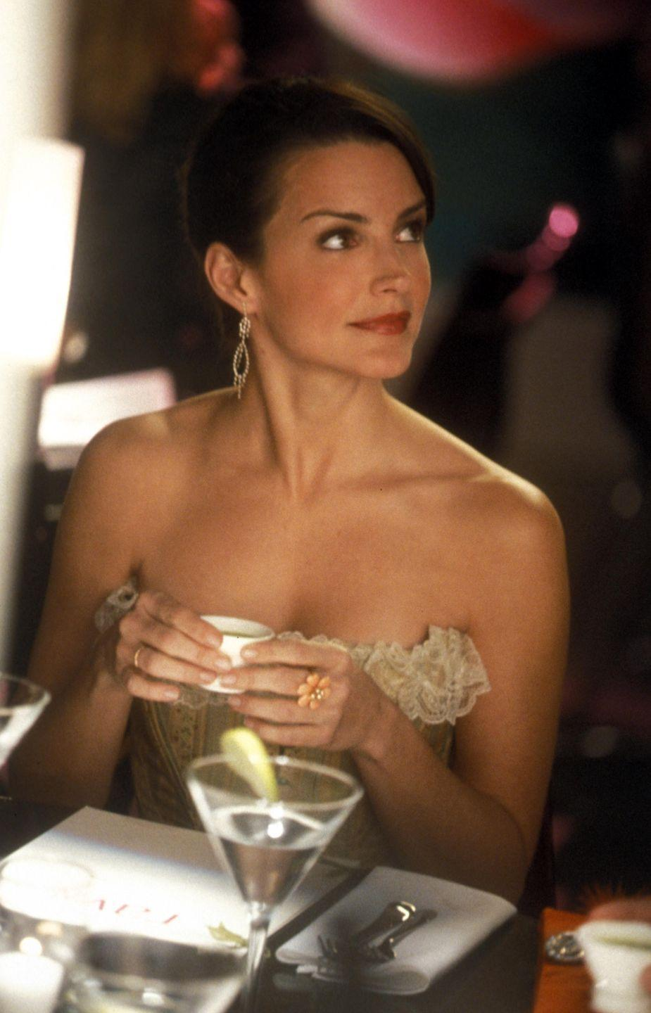 <p>Charlotte York's classic pearls, diamond earrings and floral accessories were all central to her quintessential, Audrey Hepburn-esque wardrobe. </p>