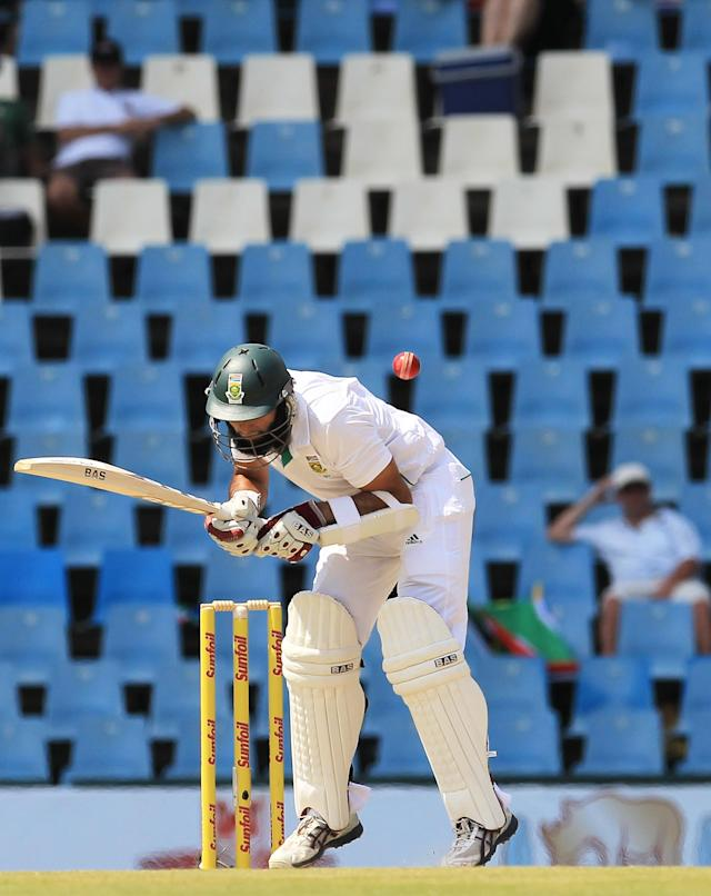 South Africa's batsman Hashim Amla, is struck by a bounce on the second day of their their cricket Test match against Australia at Centurion Park in Pretoria, South Africa, Thursday, Feb. 13, 2014. (AP Photo/ Themba Hadebe)
