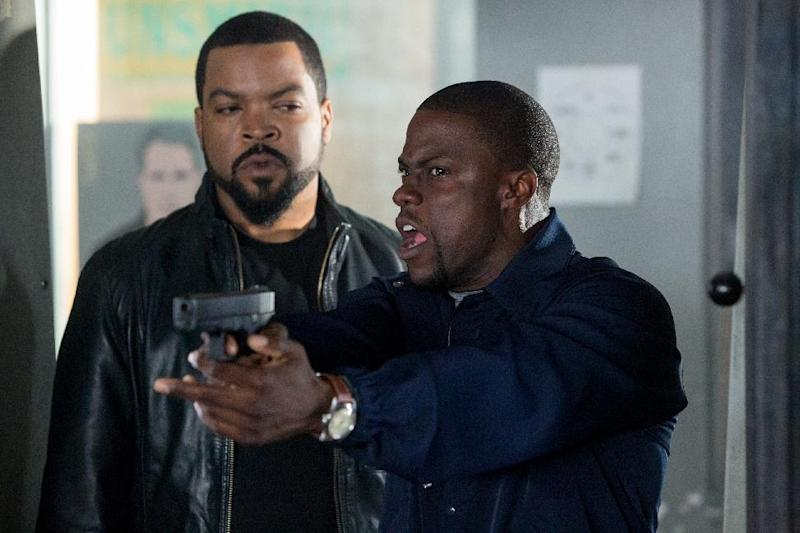 "FILE - This image released by Universal Pictures shows Ice Cube, left, and Kevin Hart in a scene from ""Ride Along."" ""Ride Along"" is likely to roll into the top spot at the weekend box office when it faces off against ""Jack Ryan: Shadow Recruit"" and ""Devil's Due."" (AP Photo/Universal Pictures, Quantrell D. Colbert, File)"
