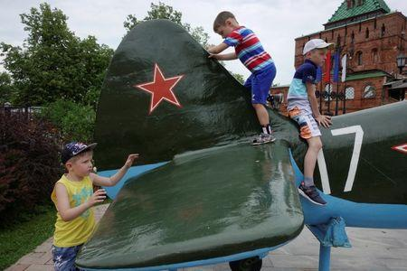 Children play on a Soviet-style military airplane at Kremlin in Nizhny Novgorod, Russia, June 30, 2018. REUTERS/Damir Sagolj