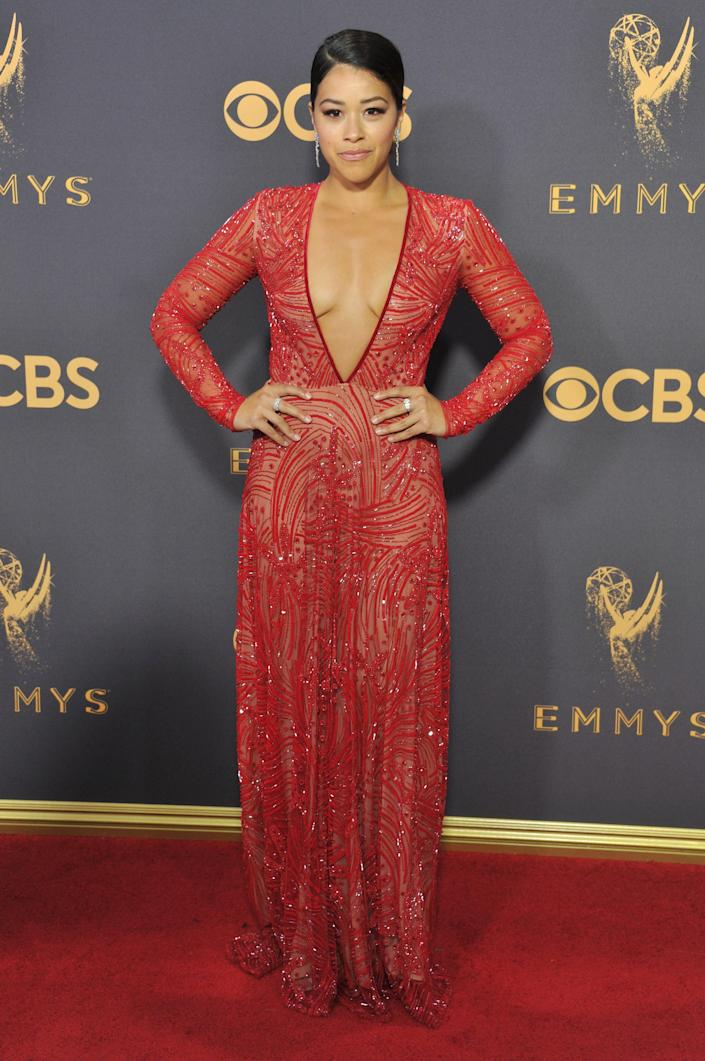 Gina Rodriguez in a red dress with a plunging neckline at the 2018 Emmys.