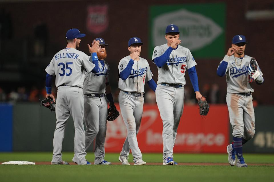 Dodgers first baseman Cody Bellinger (35) celebrates with third baseman Justin Turner (10) and second baseman Trea Turner (6) and shortstop Corey Seager (5) and right fielder Mookie Betts (right).