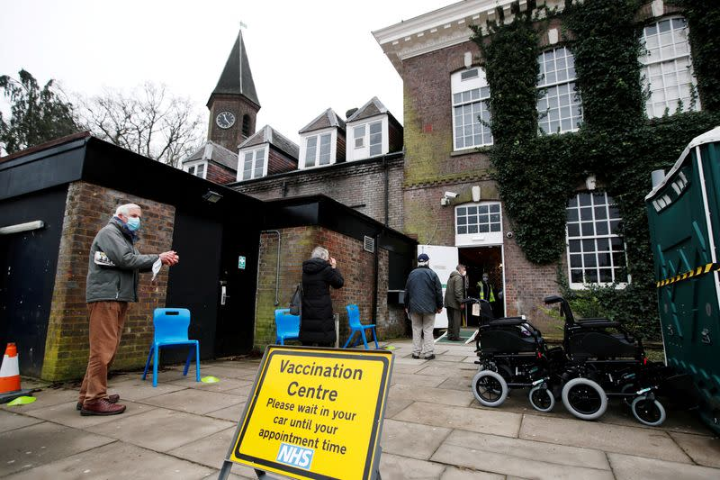 FILE PHOTO: People waiting in line for their COVID-19 vaccinations in St Albans, Britain