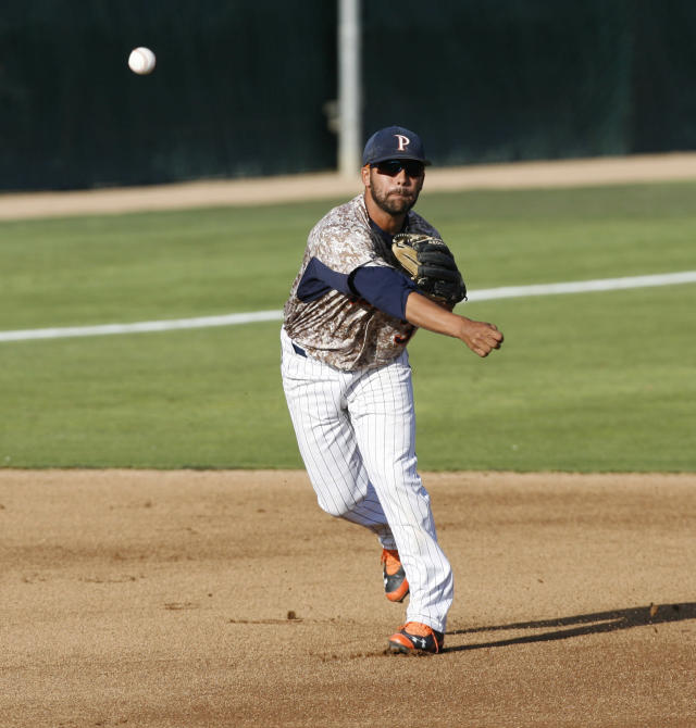 Pepperdine third baseman Austin Davidson throws to first after fielding a ground ball during the first inning of a NCAA college baseball tournament regional game against Cal Poly on Saturday, May 31, 2014, in San Luis Obispo, Calif. (AP Photo/Aaron Lambert)
