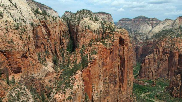 FILE - In this May 8, 2011, file photo, hikers climb down the Angels Landing trail in Zion National Park, in Utah. Zion National Park announced Monday, March 23, 2020, it is closing its campgrounds and part of a popular trail called Angel's Landing t (The Associated Press)