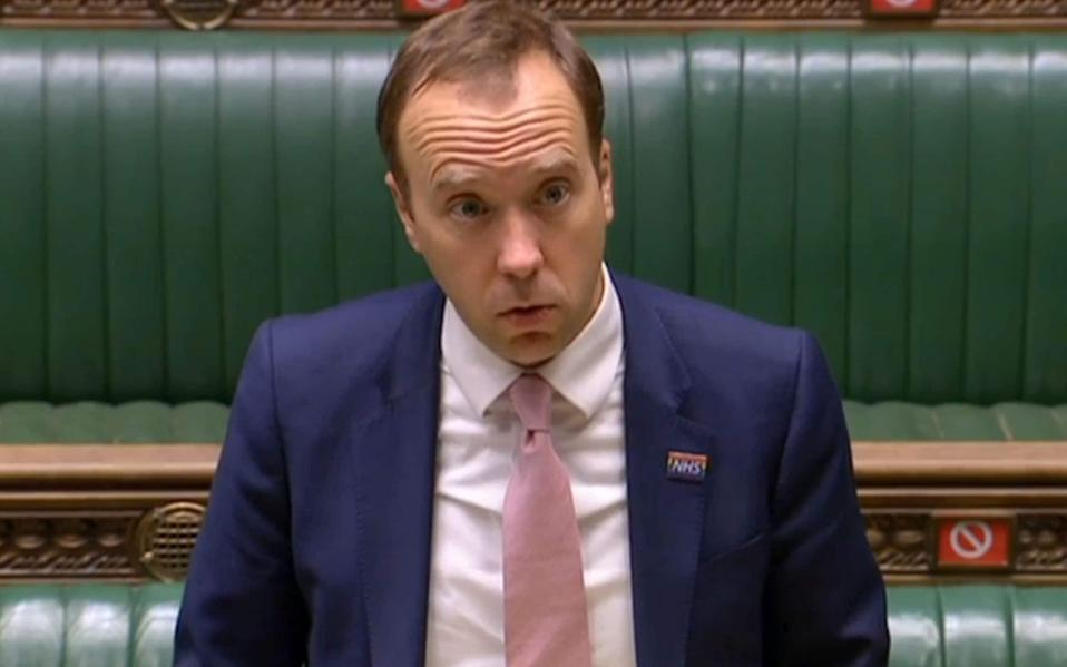 A video grab from footage broadcast by the UK Parliament's Parliamentary Recording Unit (PRU) shows Britain's Health Secretary Matt Hancock updating MPs on the COVID-19 pandemic, in the House of Commons in London - PRU/AFP via Getty Images