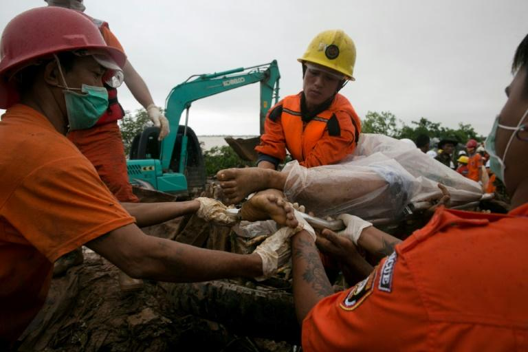 Rescue workers have recovered dozens of bodies from the landslide in Mon state and are searching for more victims