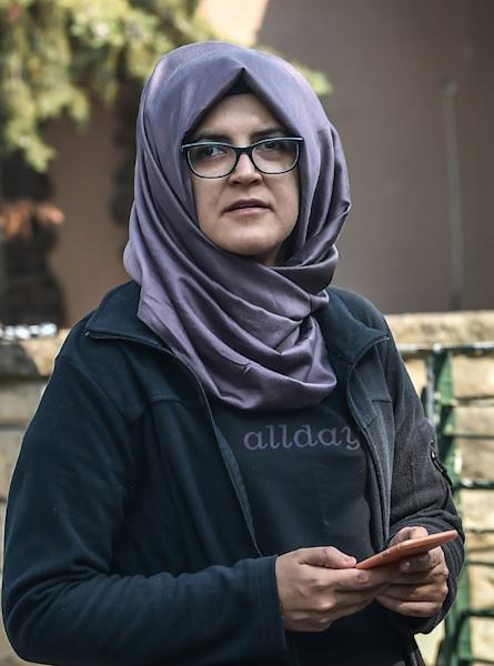Missing journalist Jamal Khashoggi's Turkish fiancee Hatice is seen waiting in front of the Saudi Arabian consulate in Istanbul