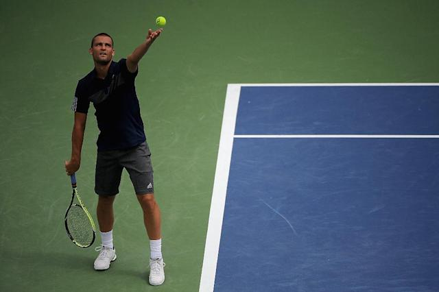 Mikhail Youzhny of Russia serves against Jo-Wilfried Tsonga of France during the Western & Southern Open, in Cincinnati, Ohio, on August 12, 2014 (AFP Photo/Jonathan Moore)