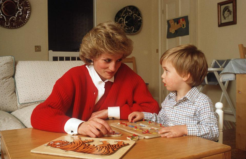 LONDON, UNITED KINGDOM - OCTOBER 22:  Princess Diana Helping Prince William With A Jigsaw Puzzle Toy In His Playroom At Home In Kensington Palace  (Photo by Tim Graham Photo Library via Getty Images)