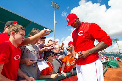 Aroldis Chapman signs autographs before a spring-training game earlier this month. (Getty)