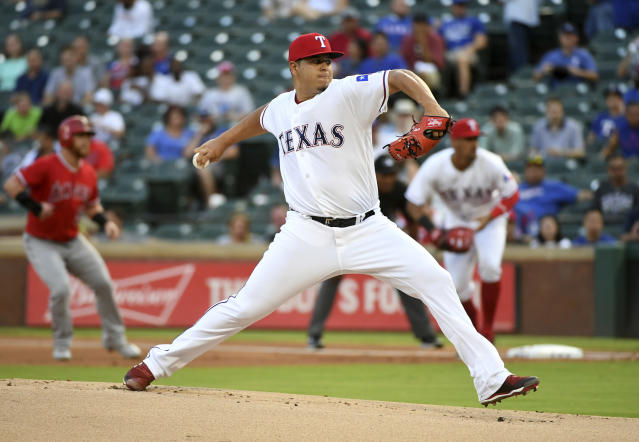 Texas Rangers starting pitcher Ariel Jurado works against the Los Angeles Angels during the first inning of a baseball game, Thursday, Aug. 16, 2018, in Arlington, Texas. (AP Photo/Jeffrey McWhorter)