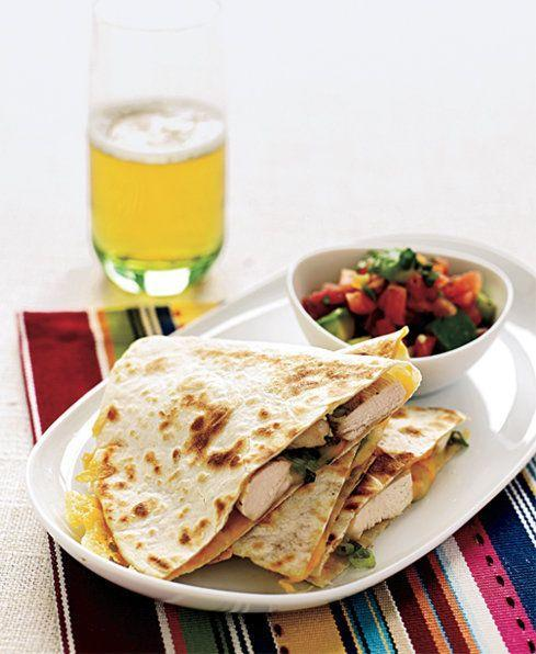"""<p>Give Tex-Mex night a healthier spin by using low-fat flour tortillas and low-fat cheese.</p><p><em><a href=""""https://www.goodhousekeeping.com/food-recipes/a8753/chicken-quesadillas-avocado-tomato-salsa-ghk0208/"""" rel=""""nofollow noopener"""" target=""""_blank"""" data-ylk=""""slk:Get the recipe for Chicken Quesadillas with Avocado-Tomato Salsa »"""" class=""""link rapid-noclick-resp"""">Get the recipe for Chicken Quesadillas with Avocado-Tomato Salsa »</a></em></p><p><strong>RELATED: </strong><a href=""""https://www.goodhousekeeping.com/food-recipes/g3674/best-mexican-recipes/"""" rel=""""nofollow noopener"""" target=""""_blank"""" data-ylk=""""slk:38 Best Mexican Dinner Recipes to Make Tonight"""" class=""""link rapid-noclick-resp"""">38 Best Mexican Dinner Recipes to Make Tonight</a></p>"""