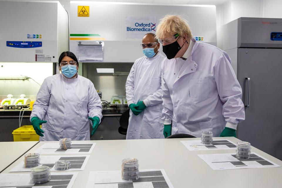 UK prime minister Boris Johnson during a visit at the quality control laboratory of Oxford Biomedica, where batches of the AstraZeneca COVID-19 vaccine are tested, in Oxford, England. Photo: Heathcliff O'Malley/Pool via Reuters