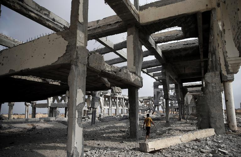 A Palestinian boy makes his way through the rubble of the destroyed and deserted terminal of Gaza's former international airport in Rafah on August 18, 2014