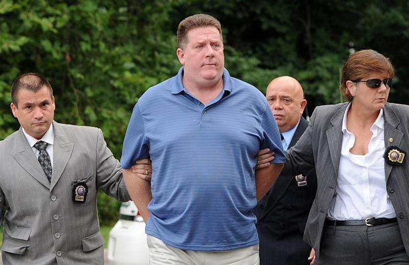 Raymond Roth, center, is escorted by law enforcement officers to the Long Island State Park Police Headquarters, Wednesday, Aug. 15, 2012 in Babylon, N.Y.  Roth is suspected of faking his own drowning at a New York beach in a scheme to collect on a life insurance policy.  The 47-year-old was reported missing by his son on July 28 at Jones Beach.  (AP Photo/Kathy Kmonicek)