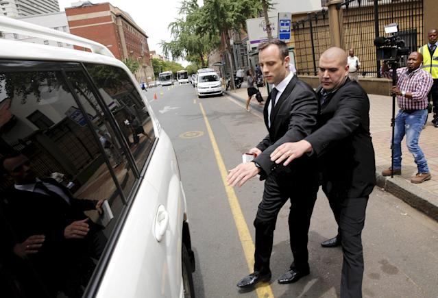 Oscar Pistorius (2nd R) leaves the North Gauteng High Court in Pretoria, South Africa after his bail hearing, in this December 8, 2015 file photo. South African Olympian Oscar Pistorius cannot challenge his conviction for the murder of girlfriend Reeva Steenkamp, a spokesman for the prosecuting authorities said on March 3, 2016. REUTERS/Sydney Seshibedi/Files