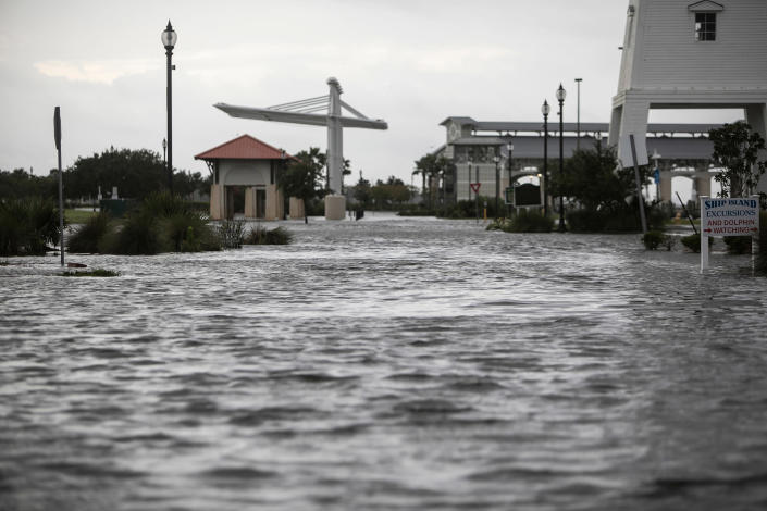 Jones Park in Gulfport, Mississippi, is flooded early Sunday, Aug. 29, 2021, from Hurricane Ida's storm surge ahead of the storm's landfall.  (Justin Mitchell / The Sun Herald via AP)
