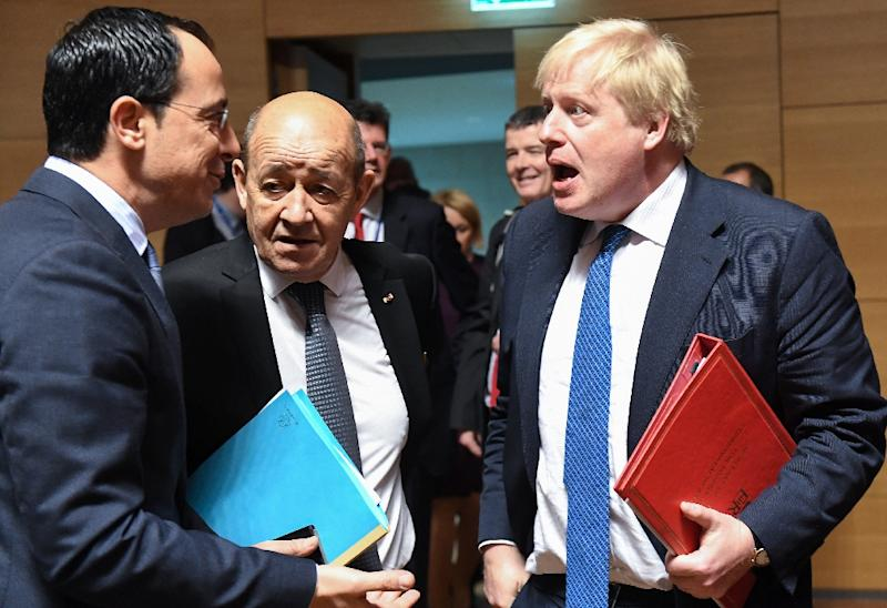 France's Foreign Minister Jean-Yves Le Drian (C), UK's Foreign Secretary Boris Johnson (R) and Cyprus' Foreign Minister Nicos Christodoulides attend an EU foreign affairs council in Luxembourg (AFP Photo/Emmanuel DUNAND)