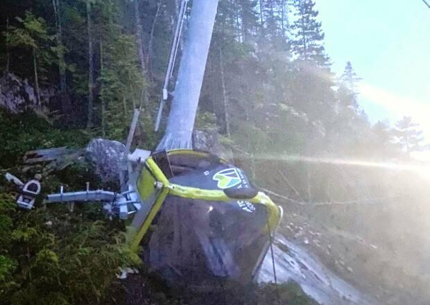 A car from the Sea to Sky gondola lies crumpled on the ground after the gondola cable was deliberately cut on Sept. 13, 2020.
