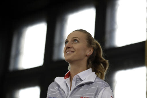 Czech Republic's Petra Kvitova poses for a photo in Prague, Czech Republic, Friday, Nov. 9, 2018 after a draw for the tennis Fed Cup Final between Czech Republic and the United States. The final takes place on Saturday, Nov. 10 and Sunday, Nov. 11, 2018 in Prague. (AP Photo/Petr David Josek)