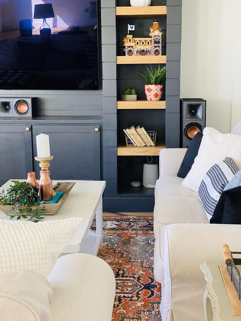 """<p>A built-in shiplap media unit? Yes, please! This stunning piece serves as the focal point of this modern media room, and offers plenty of shelf space for decor and books. </p><p><strong>See more at <a href=""""https://www.honeybearlane.com/2020/10/modern-finished-basement-living-room-reveal.html"""" rel=""""nofollow noopener"""" target=""""_blank"""" data-ylk=""""slk:Honeybear Lane"""" class=""""link rapid-noclick-resp"""">Honeybear Lane</a>. </strong></p><p><a class=""""link rapid-noclick-resp"""" href=""""https://go.redirectingat.com?id=74968X1596630&url=https%3A%2F%2Fwww.walmart.com%2Fip%2FBetter-Homes-Gardens-White-Wood-Planter-with-20-Green-Yellow-Faux-Snake-Plant%2F627080921&sref=https%3A%2F%2Fwww.redbookmag.com%2Fhome%2Fg36061437%2Fbasement-ideas%2F"""" rel=""""nofollow noopener"""" target=""""_blank"""" data-ylk=""""slk:SHOP FAUX PLANTS"""">SHOP FAUX PLANTS</a></p>"""