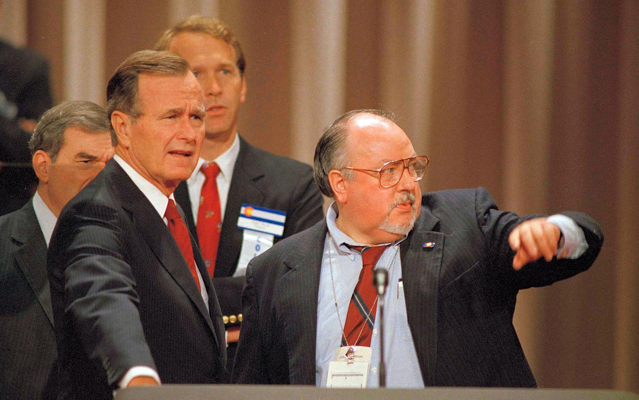 <p>Vice President George H.W. Bush, left, gets some advice from his media adviser, Roger Ailes, right, as they stand behind the podium at the Superdome in New Orleans, prior to the start of the Republican National Convention on Aug. 17, 1988. (Photo: Ron Edmonds/AP) </p>