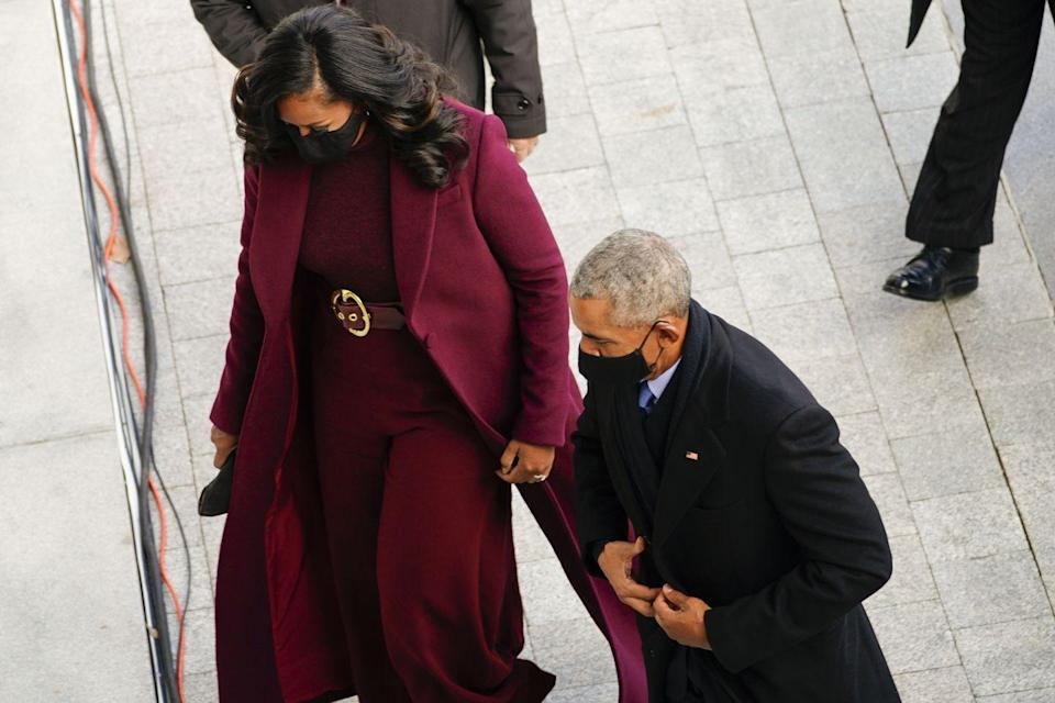 <p>Former First Lady Michelle Obama and former President Barack Obama arrive at the inauguration </p>