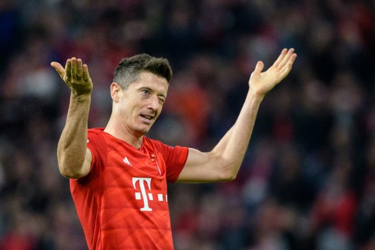 Having netted his 200th goal for Bayern Munich on Wednesday, striker Robert Lewandowski is looking to extend his goal-scoring run to seven straight matches on Saturday at home to Cologne. (AFP Photo/Matthias Balk)