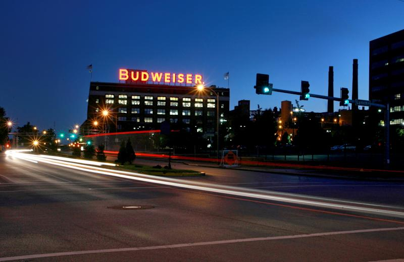 In this July 13, 2008 photo cars move near the Anheuser-Busch St. Louis brewery. August Busch III was CEO of Anheuser-Busch Companies for nearly three decades before his 2002 retirement, remaining as board chairman until 2006. The St. Louis brewer is being sued for gender discrimination by Francine Katz, who was the company's highest ranking female executive before her 2008 resignation. Katz says she was grossly underpaid compared to her male predecessor and other top male executives at the company. (AP Photo/St. Louis Post-Dispatch, David Carson)