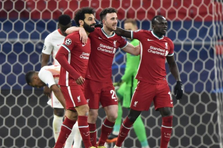Mohamed Salah (left)and Sadio Mane (right)scored the goals as Liverpool beat RB Leipzig 2-0 to reach the Champions League quarter-finals