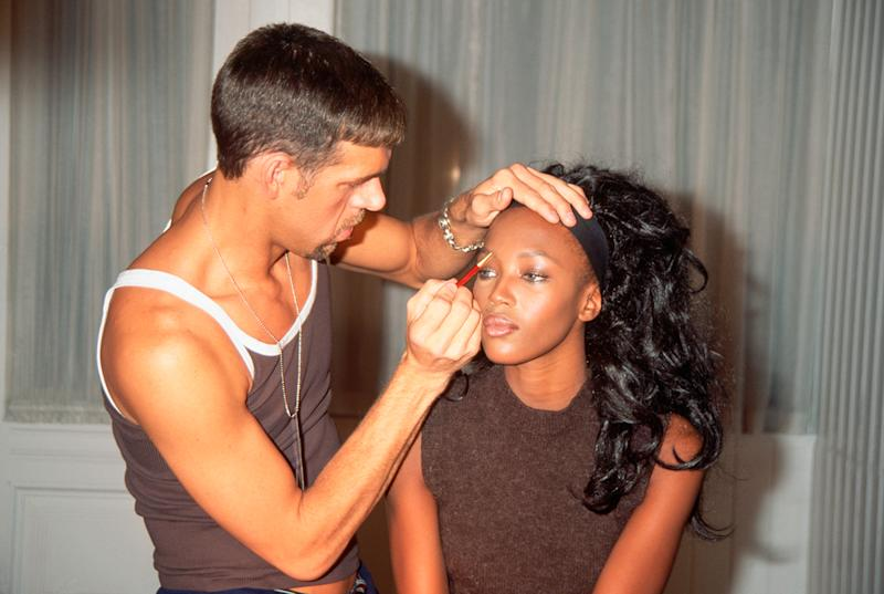 Makeup artist Kevyn Aucoin applies makeup to supermodel Naomi Campbell backstage at a Todd Oldham fall line fashion show, 1996. (Photo: Getty Images)