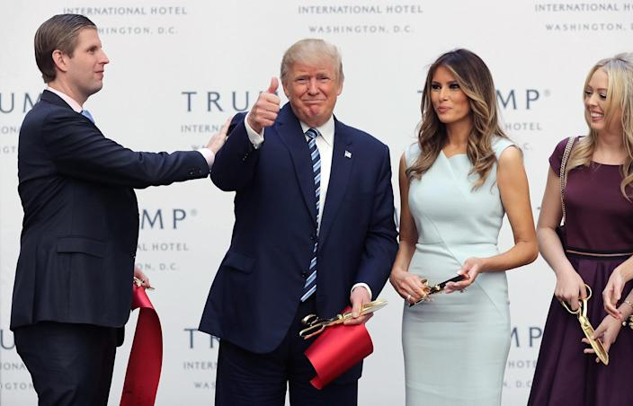 Republican presidential nominee Donald Trump gives a thumbs-up after cutting the ribbon at the new Trump International Hotel with his son Eric Trump, left, wife Melania Trump and daughter Tiffany Trump, right, on Oct. 26, 2016, in Washington. (Photo: Chip Somodevilla/Getty Images)