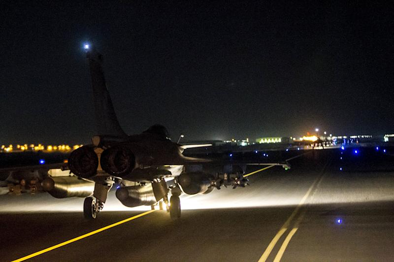 A French fighter jet taxis along the runway in an undisclosed location, in this handout picture released by the ECPAD late November 15, 2015. French fighter jets launched their biggest raids in Syria to date targeting the Islamic State's stronghold in Raqqa just two days after the group claimed coordinated attacks in Paris on Friday that killed more than 130 people, the defence ministry said. REUTERS/ECPAD-French Defence Ministry/Handout via Reuters  TPX IMAGES OF THE DAY ATTENTION EDITORS - THIS PICTURE WAS PROVIDED BY A THIRD PARTY. REUTERS IS UNABLE TO INDEPENDENTLY VERIFY THE AUTHENTICITY, CONTENT, LOCATION OR DATE OF THIS IMAGE. FOR EDITORIAL USE ONLY. NOT FOR SALE FOR MARKETING OR ADVERTISING CAMPAIGNS. THIS PICTURE IS DISTRIBUTED EXACTLY AS RECEIVED BY REUTERS, AS A SERVICE TO CLIENTS. FOR EDITORIAL USE ONLY. NO RESALES. NO ARCHIVE.