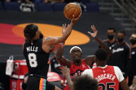 San Antonio Spurs guard Patty Mills (8) shoots over Toronto Raptors forward Pascal Siakam (43) and forward Chris Boucher (25) during the second half of an NBA basketball game Wednesday, April 14, 2021, in Tampa, Fla. (AP Photo/Chris O'Meara)