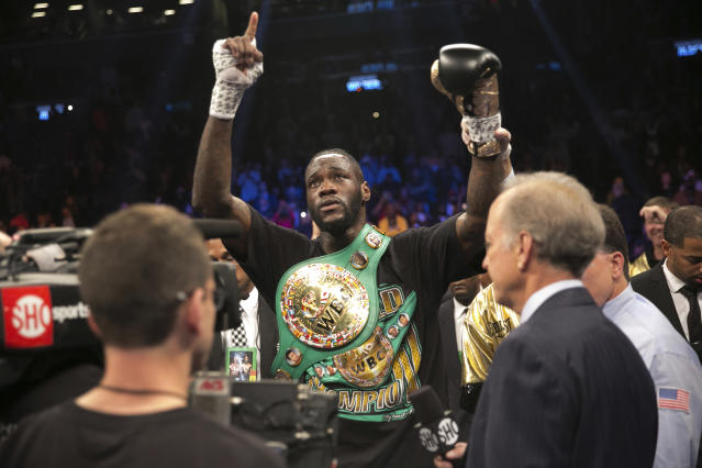 WBC heavyweight champ Deontay Wilder called out Anthony Joshua for a fight back in March, but it's not happening yet. (AP)