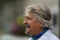 Steve Asmussen, trainer of Kentucky Derby entrant Super Stock, talks to the media after a workout at Churchill Downs Wednesday, April 28, 2021, in Louisville, Ky. The horse is co-owned by Asmussen's parents with a partner. (AP Photo/Charlie Riedel)