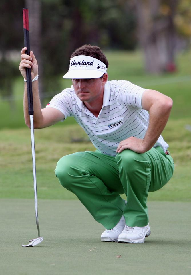 Keegan Bradley kneels on the second hole green during the third round of the Cadillac Championship golf tournament on Saturday, March 10, 2012 in Doral, Fla. (AP Photo/Lynne Sladky)