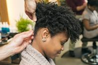 <p>Continue to twist and pin the hair all around the head. Don't worry about parting hair perfectly; just grab and go. All the twists should end near one central point at the crown of the head. In order to keep the twists smooth and flyaways scarce, use a pomade on your fingers as you style.</p>