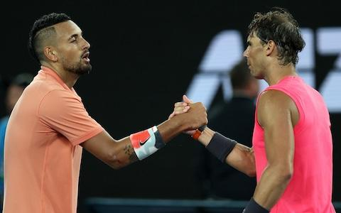 The two players show their respect for each other following the four-set thriller - Credit: GETTY IMAGES