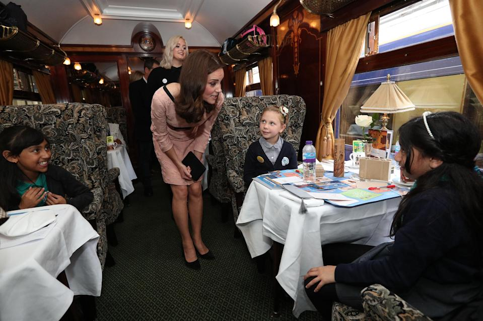 She was also spotted talking to children on board the Belmond British Pullman train [Photo: PA]