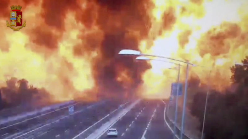 In this frame grab taken from a video released by the Italian police, the moment a truck that was transporting flammable substances explodes after colliding with another truck on a highway in the outskirts of Bologna, Italy, Monday, Aug. 6, 2018. The explosion killed at least two people and injured up to 70 as a section of the thoroughfare collapsed, police said. (Italian Police video via AP)