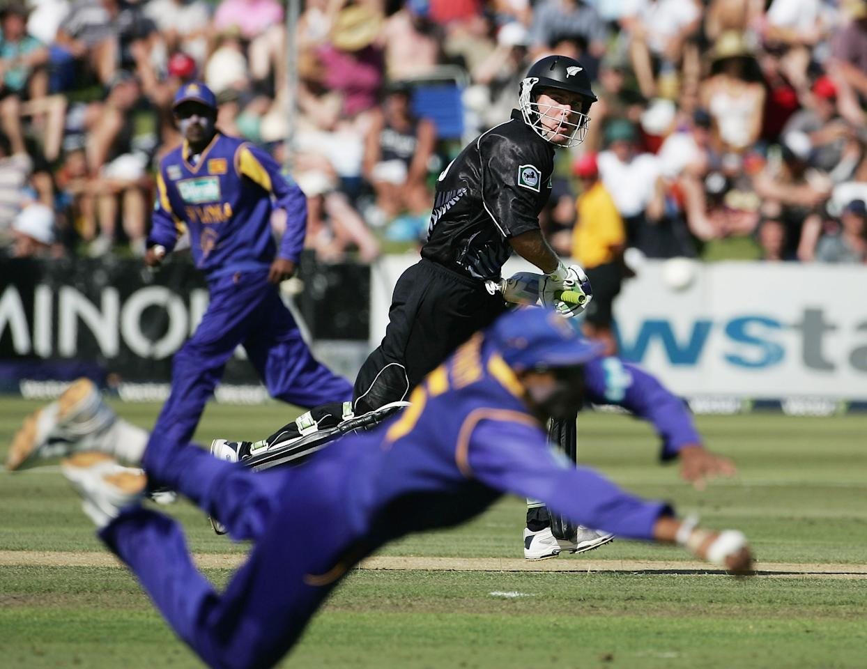 QUEENSTOWN, NEW ZEALAND - DECEMBER 31:  Jamie How of New Zealand watches the ball pass a Sri Lankan fielder during the first One Day International match between New Zealand and Sri Lanka at the Queenstown Events Centre December 31, 2005 in Queenstown, New Zealand.  (Photo by Phil Walter/Getty Images)