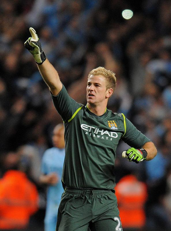 "Manchester City's English goalkeeper Joe Hart celebrates after beating Manchester United during their English Premier League football match at The Etihad stadium in Manchester, north-west England on April 30, 2012. AFP PHOTO/ANDREW YATES RESTRICTED TO EDITORIAL USE. No use with unauthorized audio, video, data, fixture lists, club/league logos or ""live"" services. Online in-match use limited to 45 images, no video emulation. No use in betting, games or single club/league/player publications.ANDREW YATES/AFP/GettyImages"