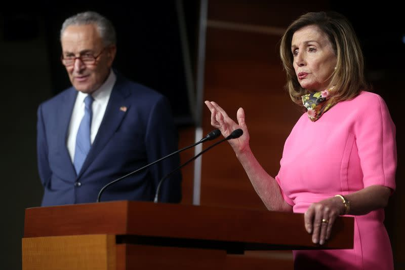 U.S. House Speaker Nancy Pelosi (D-CA), speaks next to Senate Minority Leader Chuck Schumer (D-NY), during a news conference on Capitol Hill in Washington