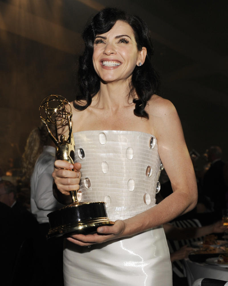 """The Good Wife"" cast member Julianna Margulies poses with the Emmy for best lead actress in a drama series  at the 63rd Primetime Emmy Awards Governors Ball on Sunday, Sept. 18, 2011 in Los Angeles. (AP Photo/Chris Pizzello)"