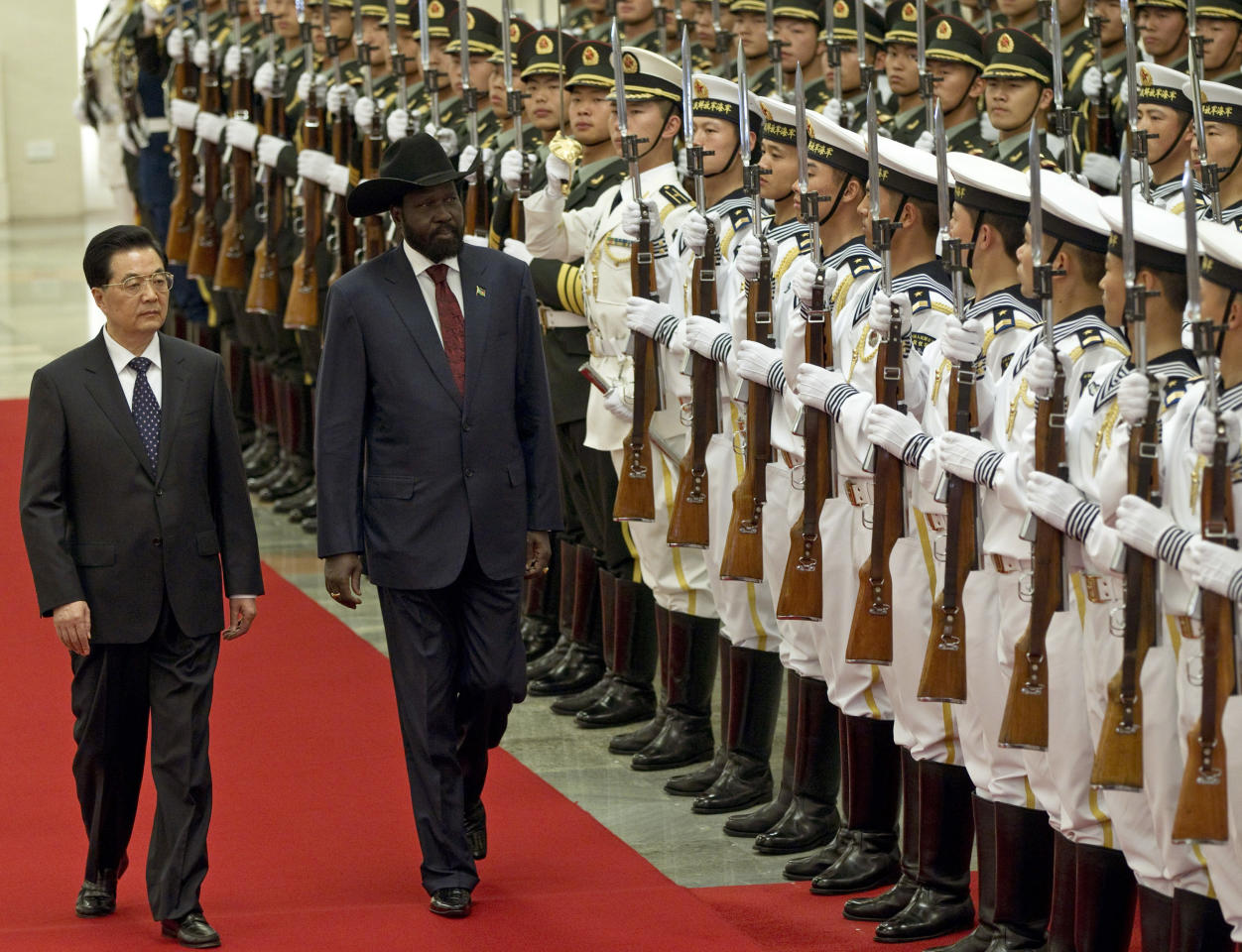 South Sudan's President Salva Kiir, right, reviews honor guard with Chinese President Hu Jintao, left, during a welcoming ceremony at the Great Hall of the People in Beijing, China, Tuesday, April 24, 2012. (AP Photo/Alexander F. Yuan)